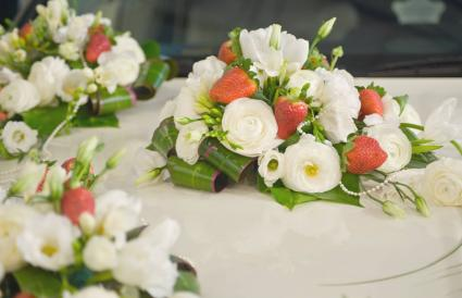 Bridal bouquet of flowers and strawberries