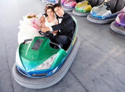 Newlyweds in amusement park