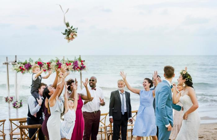 af958a7a2eb Bride throwing the bouquet at wedding Source. Ocean-themed weddings ...