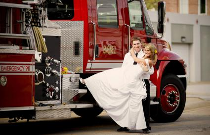 Couple in front of fire truck