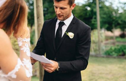 Groom reading poem to bride