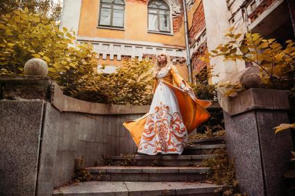 Bride wearing a period dress for a Halloween wedding