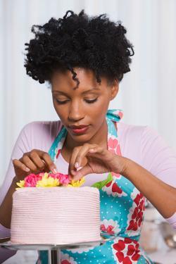 woman making diy wedding cake