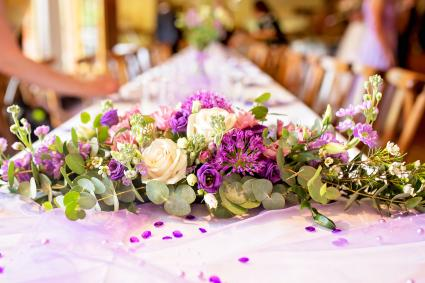 Elegant table setup in purple pastels for a restaurant wedding