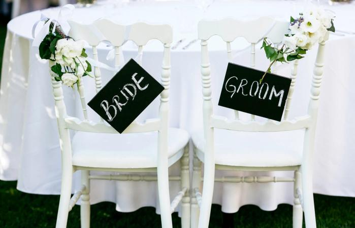 bride and groom seats at head table