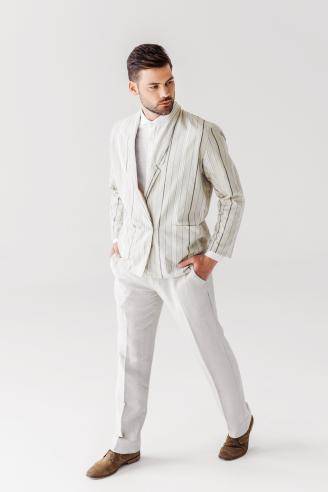 Young man in vintage stylish suit looking away on white