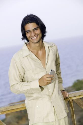 Man wearing guayabera shirt in a outdoor terrace