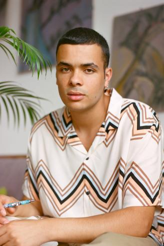 Young man wearing a nice beach silk shirt