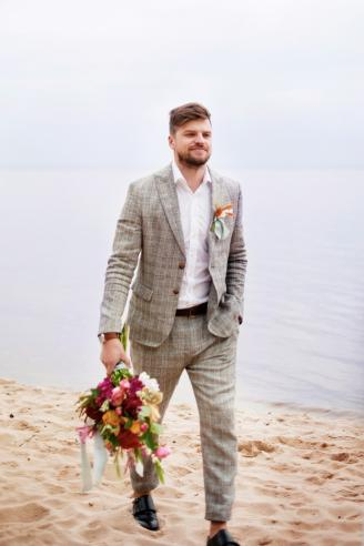 Man attending a wedding at the beach