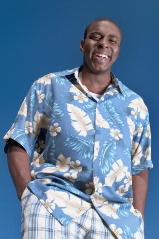 Smiling man wearing Hawaiian shirt