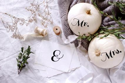 wedding desktop stationery scene with eucalyptus, ribbons, white pumpkins and gypsophila flowers