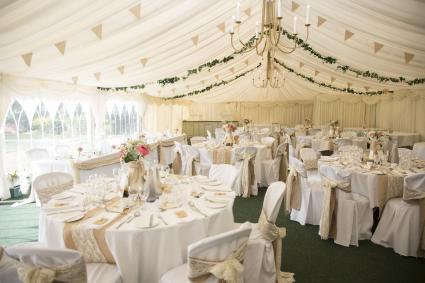 Wedding reception tables under tent