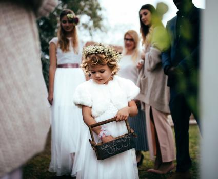 flower girl with basket at ceremony