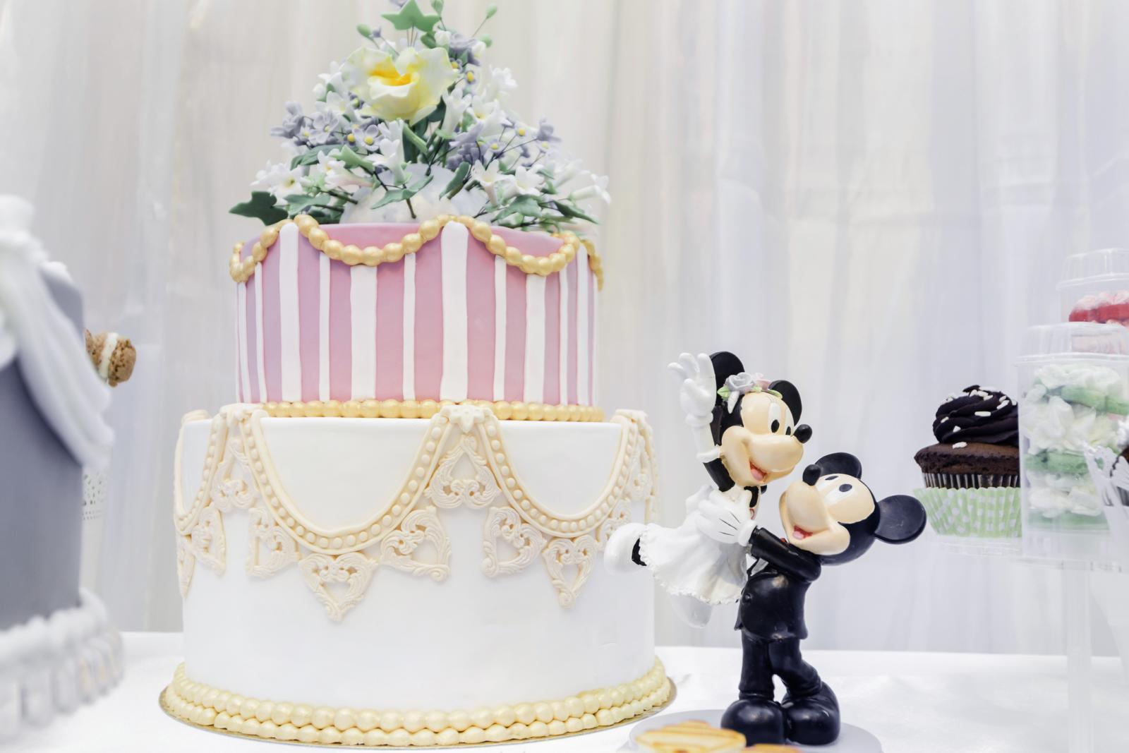 Miniature marzipan Mickey and Minnie wedding cake