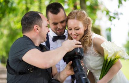Wedding photographer showing the photos
