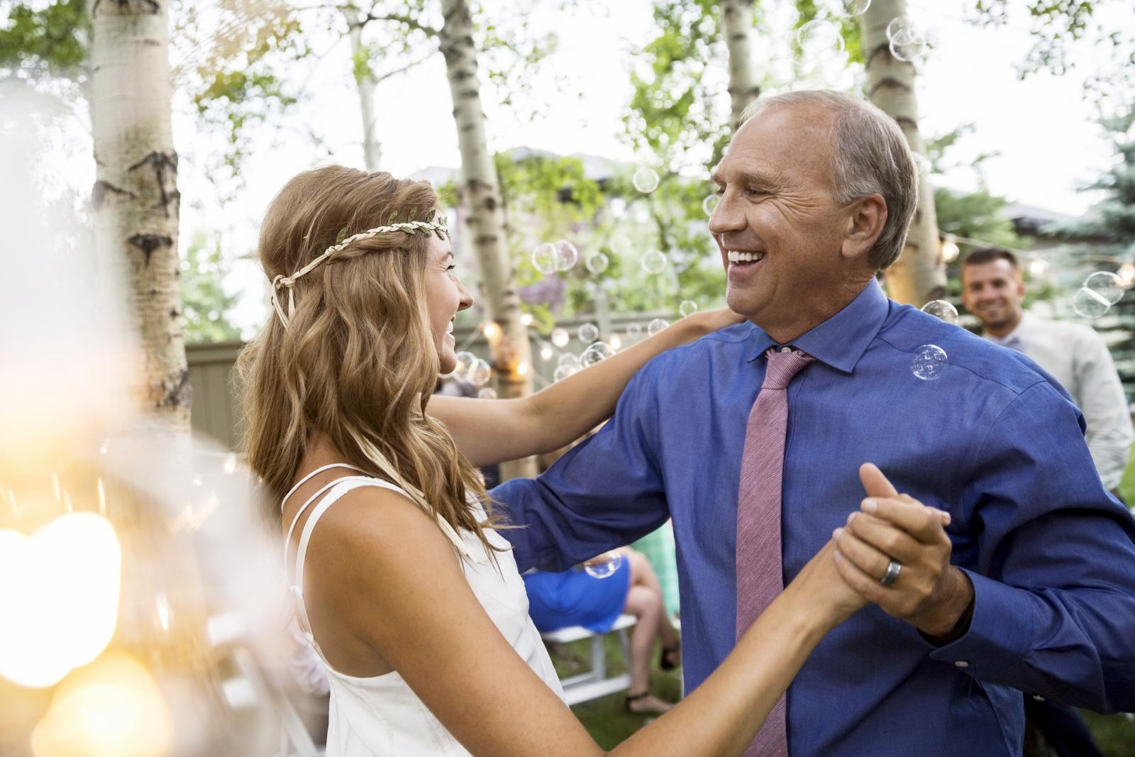 Bride and father dancing at backyard wedding reception