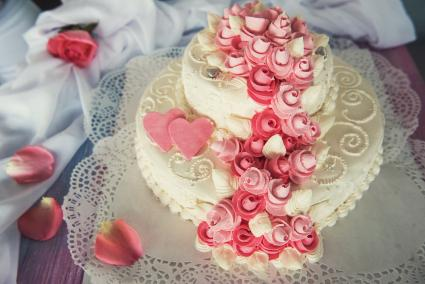 Valentine heart shaped wedding cake with frosting roses