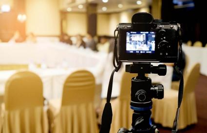 Video Camera Against Chairs At Wedding Event