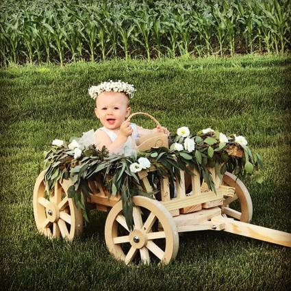 wedding wagon with flower girl
