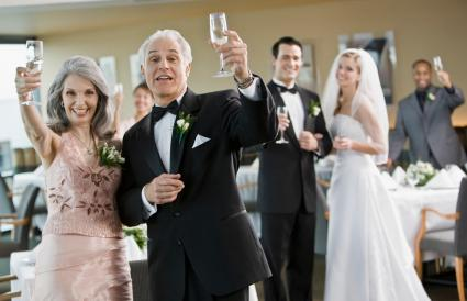 Parents toasting bridal couple