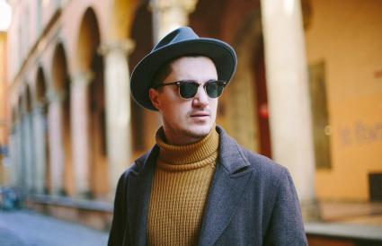 man in hat and turtleneck