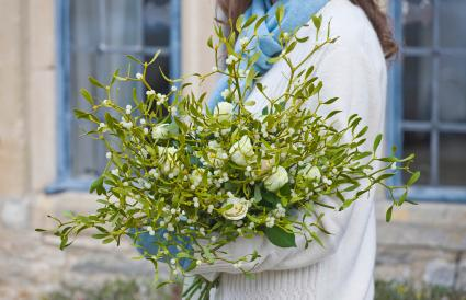 bouquet of mistletoe and white roses