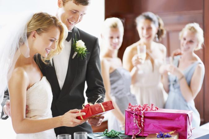Wedding couple opening gifts