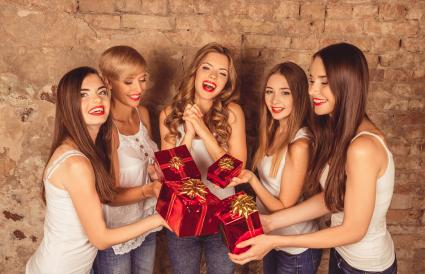girls giving presents to their friend