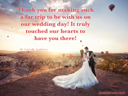Married couple at sunset with hot air balloons in the background with a thank you message quote for wedding guests