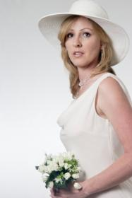 Bride in a casual wedding dress and hat