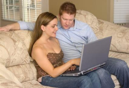 Engaged couple looking at a wedding website