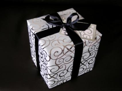 A wedding gift tied with a black ribbon