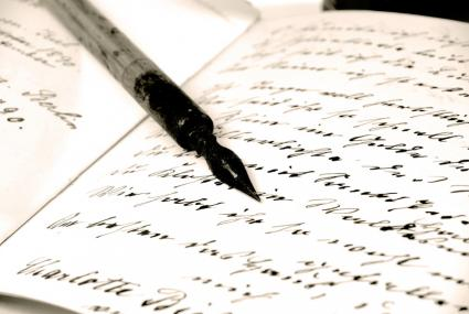 A calligraphy pen and a notebook with writing