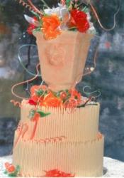 3-tier wedding cake with red and orange flowers