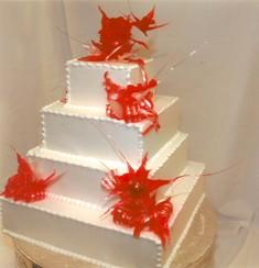 4-tier wedding cake with red sugar flowers