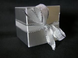 A silver foil wedding reception favor box