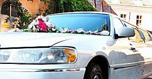 Wedding flowers decorating a white limo