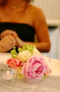 Guest at a wedding table with flowers