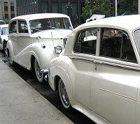 Rolls Royce limos waiting outside a wedding