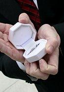 Best man holding the wedding rings box