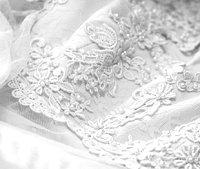 Lace details on a 1950s-style wedding dress