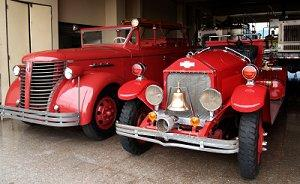 Vintage fire trucks parked at the station