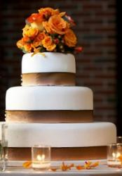 A firefighter's wedding cake with flame-colored flowers