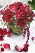 Silk rose petals around a wedding centerpiece