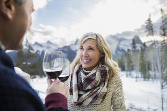 Couple in winter with red wine