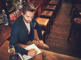 Man writing in a wine journal