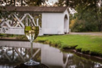 Glass of wine and a Southern Oregon covered bridge