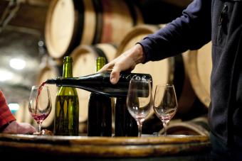 Pouring wine in a Burgundy cellar