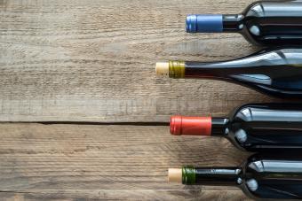 Red wine bottles on barnwood