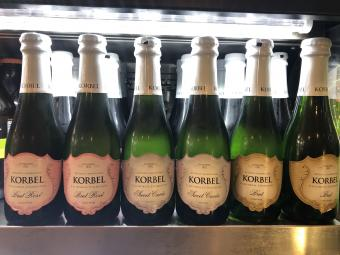 Korbel Champagne Bottles lined up in a row
